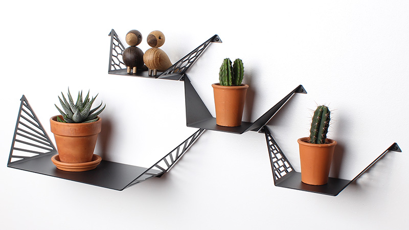 Design your own wall with one large shelf and three small shelves styled with Kay Bojesen Love Birds and cacti.