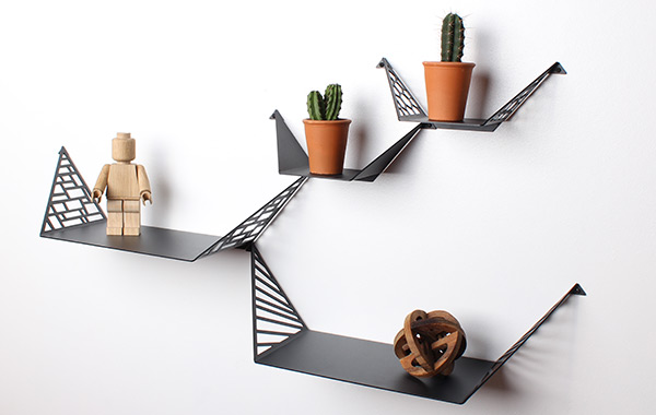 two large shelves and two small shelves from By Dyb styled with Cacti, large wooden lego figure and round wooden sculpture