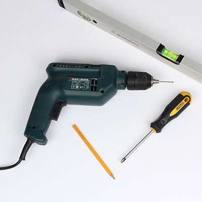Tools for hanging wall hook: spirit level, pencil, drill, screwdriver.