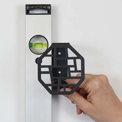 BY DYB wall hook is held up against a spirit level