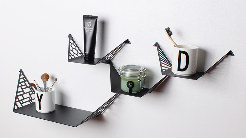 Bathroom decorated with shelves from BY DYB styled with scented candle, make-up brushes, toothbrush and Designletters cups