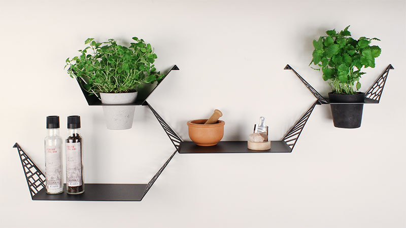 Shelves for the kitchen, from BY DYB, with fresh herbs in plant hangers, spice grinders and spices