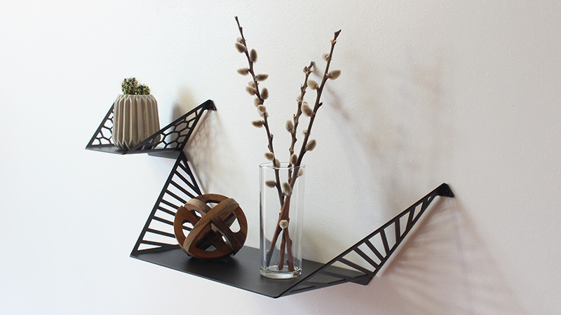 Decorate your living room with beautiful shelves, decorate with cactus, wooden sculpture and branches in a vase