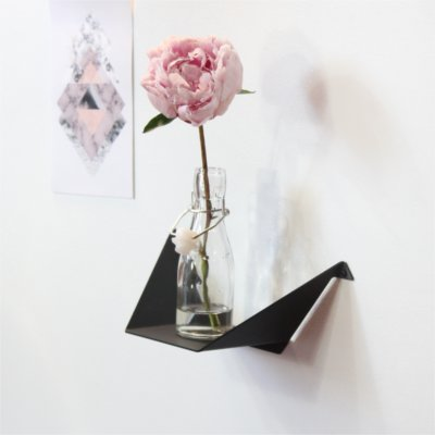 Small shelf with flower and picture