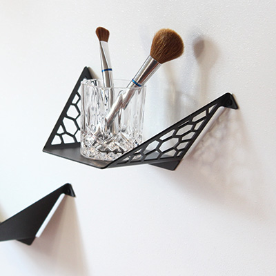 Small shelf with makeup brushes