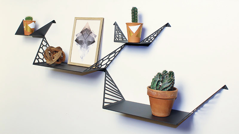 Shelves from BY DYB styled with Kay Bojesen Monket, wooden sculpture and cacti in small flower pots painted in graphic patterns