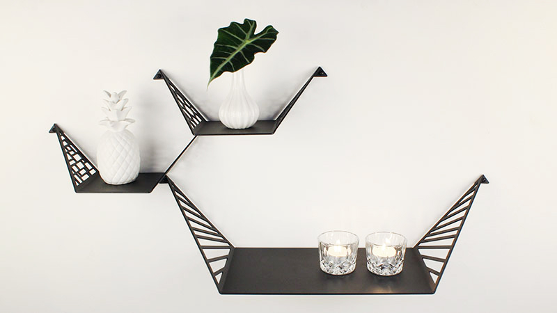 Shelves for the wall styled in feminine look with small vase with leaf, tealights and white ceramic pineapple