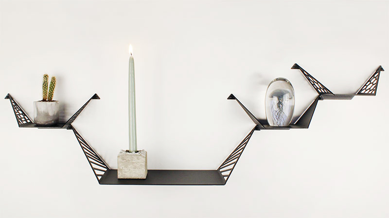 Shelves for the wall from BY DYB styled with cactus i concrete flower pot, concrete candleholder and glass jellyfish