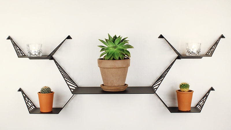 Balanced setup and shelves from BY DYB styled with large succulent, small cacti and tealights